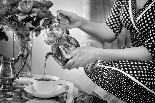 lady in polka dress pouring tea
