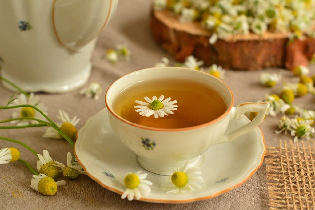 Chamomile Tea in a floral cup with a saucer